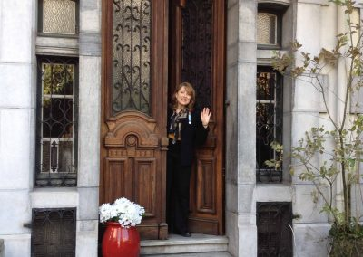 Pam-waving-in-door